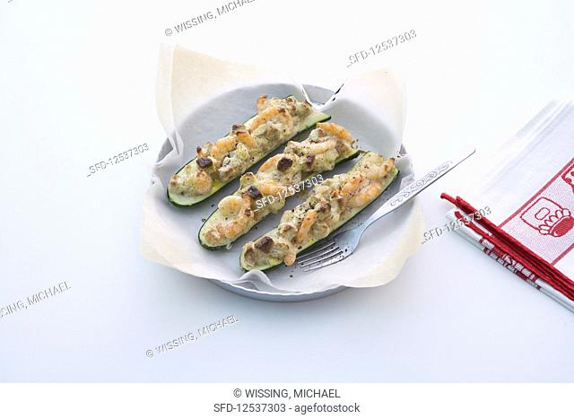 Courgettes filled with prawns with croutons and cream cheese