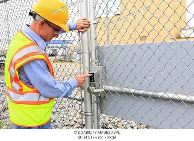 Electrical engineer using security system to enter electrical power plant
