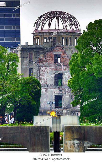 The Genbaku Domu, Atomic Bomb Dome, and the Peace Flame in the Hiroshima Peace Memorial Park, Hiroshima, Japan commemorating the bombing of Hiroshima at the end...