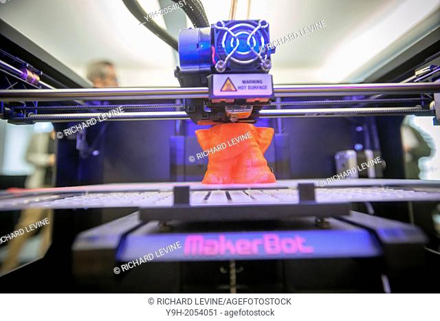 A $2199 MakerBot Industries ''Replicator 2'' 3d printer churns out a scanned gnome figure in the MakerBot offices in New York