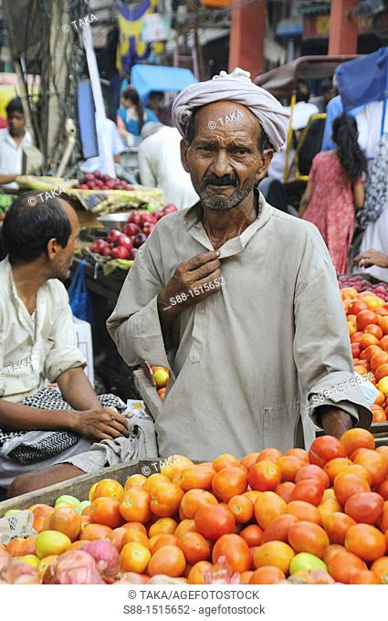 Man selling tomato on the street