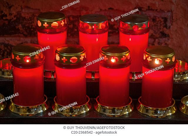 Red holy candles, lit in a church, Venice, Italy