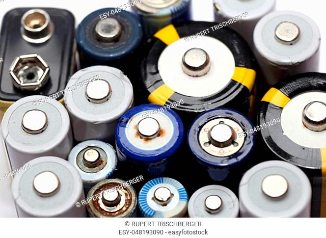 many different batteries on a white board