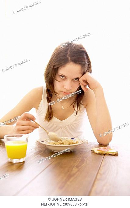 Teenager having breakfast
