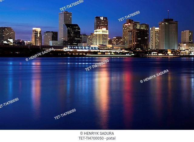 USA, Louisiana, New Orleans, Mississippi River and skyline illuminated at night