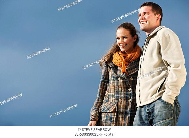 Young couple smiling while hugging