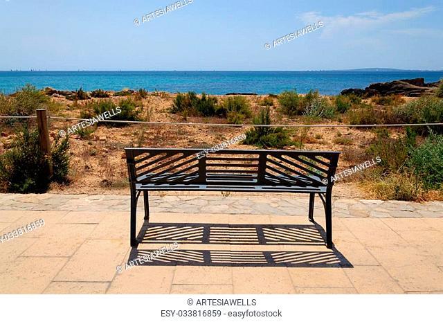 Park bench by the Mediterranean ocean, Majorca, Spain. Copa del Rei regatta in the bay