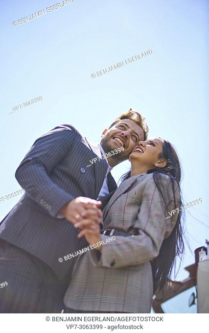 Couple holding hands. Turkish ethnicity. High society. Blogger Adem Bayalan. Bavaria, Germany