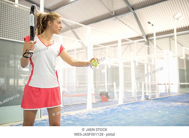 Female paddle tennis player on court
