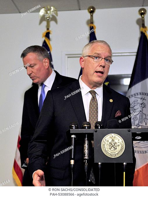 Mayor Bill de Blasio of New York City, left, steps aside as NYPD Deputy Commissioner of Intelligence & Counter-terrorism John Miller answers a question during a...