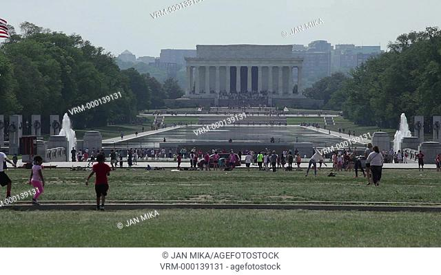 Washington DC, USA - 16 May 2015: The Lincoln Memorial and people around the reflecting pool in National Mall