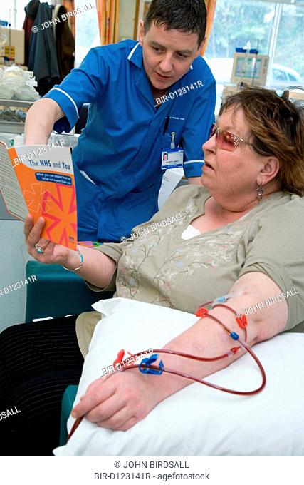 Nurse going through an NHS leaflet with a patient on the Nottingham City Hospital Renal Unit