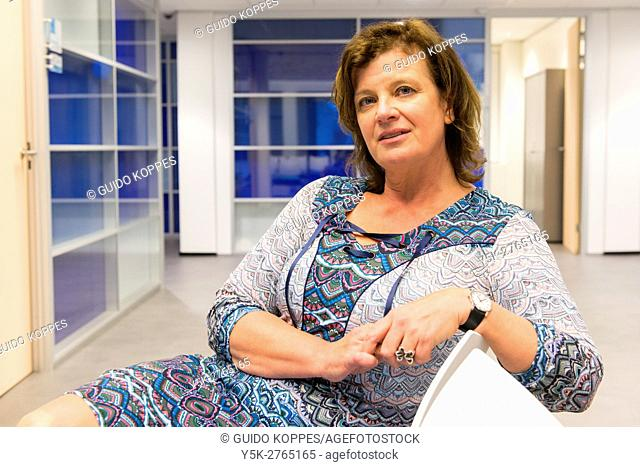 Breda, Netherlands. Business office portrait of a female mid adult manager, working inside a public organisation