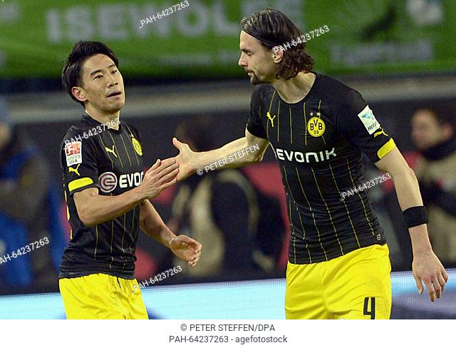 Dortmund's Shinji Kagawa (L) celebrates his 2-1 goal with Neven Subotic at the German Bundesliga soccer match between VfL Wolfsburg and Borussia Dortmund in the...