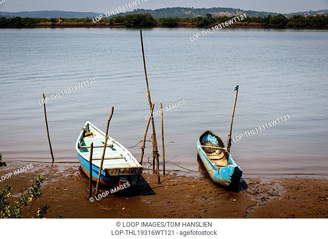 Boats on the shore of The Mandovi River in Goa