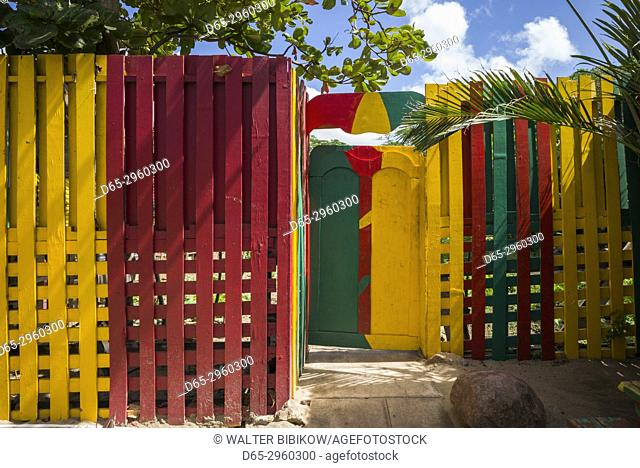 St. Kitts and Nevis, Nevis, Pinneys Beach, colorful fence