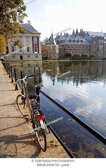 Bicycle and ornate Dutch buildings near pond