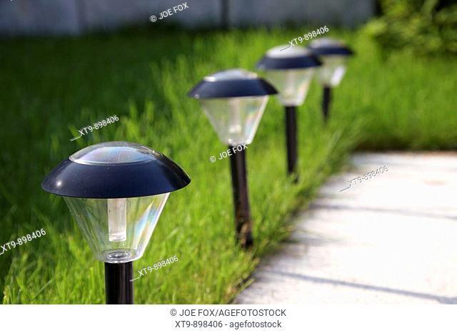 solar garden lighting being used to light pathway in garden in the uk