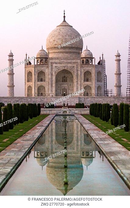 The reflex of Taj Mahal in the water in a hot summer afternoon. Agra, Uttar Pradesh. India