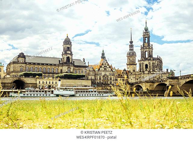 Germany, Dresden, Elbe River with Hausmannsturm, Dresden Cathedral, appellate courthouse and Augustus Bridge