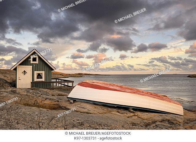 Hut and boat on coast, Smögen, Bohuslän, Sweden, Scandinavia, Europe