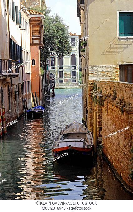 Small boats on a canal, Dorsoduro, Venice, Italy