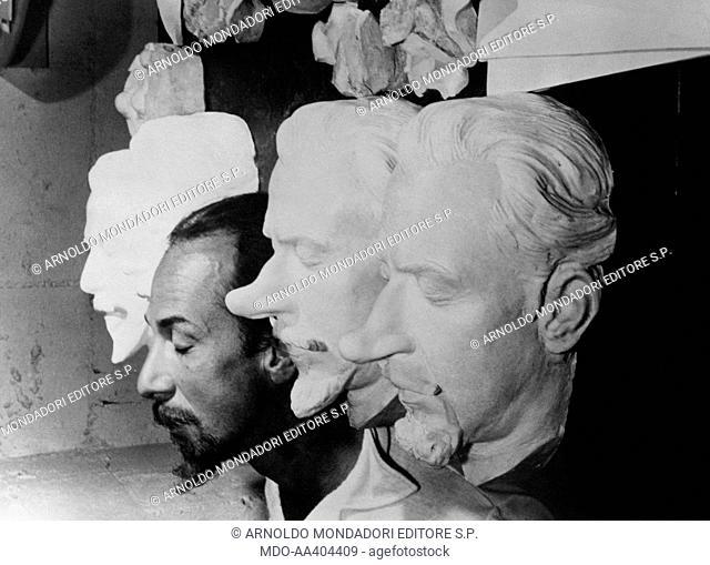 José Ferrer on the movie set of Cyrano de Bergerac. Puerto Rican-born American actor and director José Ferrer posing among some Cyrano de Bergerac masks