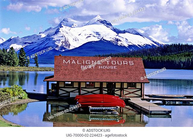 The Boat House at Maligne Lake with snow capped mountains