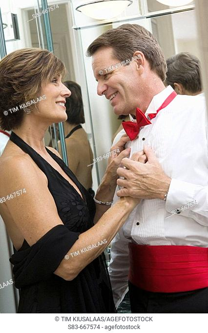 Couple in bathroom getting ready for a formal night out