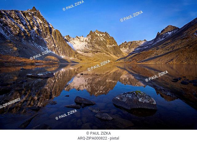 Reflection Of Mountain In Grizzly Lake During Sunrise In Canada