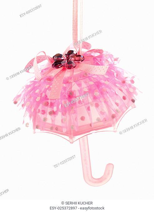 Christmas decoration pink umbrella isolated on white background