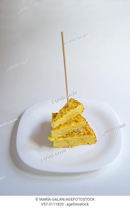 Three stacked pieces of Spanish omelet