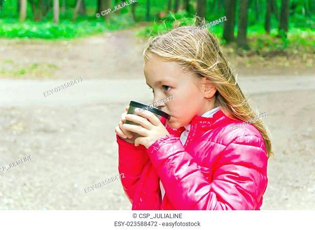 Cute girl drinking beverage