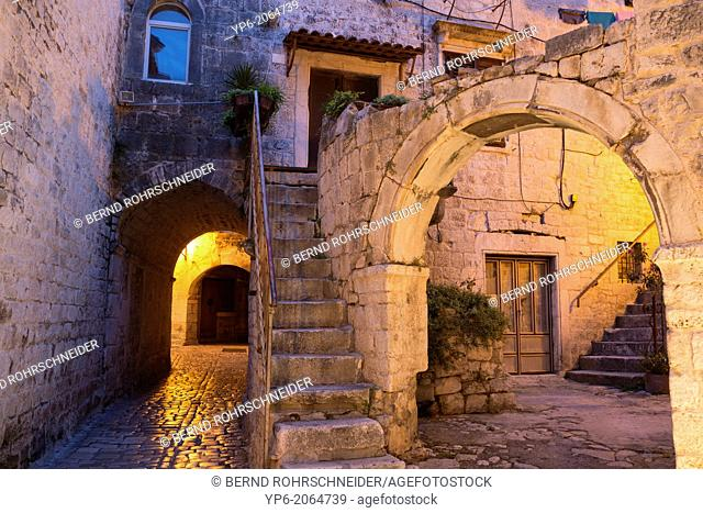 archway and house in old town of Trogir at night, Croatia