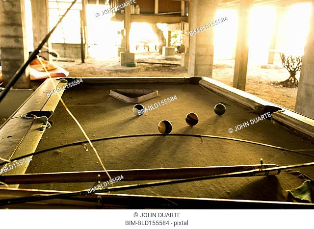Fishing rods and pool cues on pool table