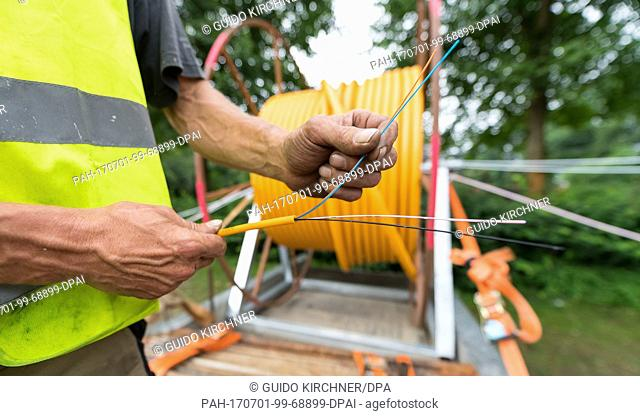 Earthwork construction is done in order to install glass fiber cables in Warendorf, Germany, 28 June 2017. In cooperation with the city of Warendorf the company...