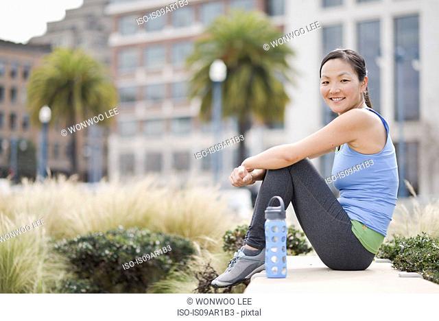 Female runner taking break, San Francisco, California