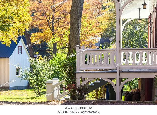 Canada, Quebec, Ile d'Orleans, Sainte-Petronille, traditional house in autumn