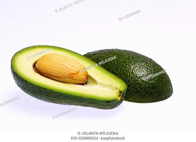 half avocado with stone isolated on white background