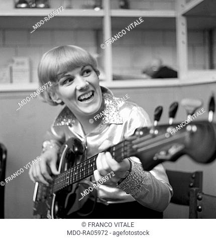 Italian singer Caterina Caselli playing a guitar. Italy, 1965