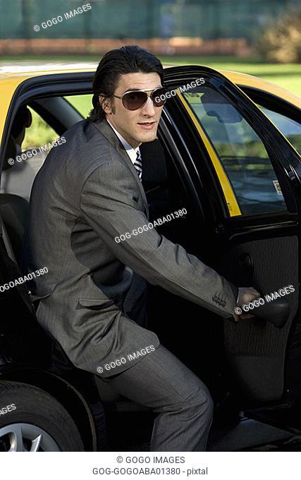 Businessman getting into a cab