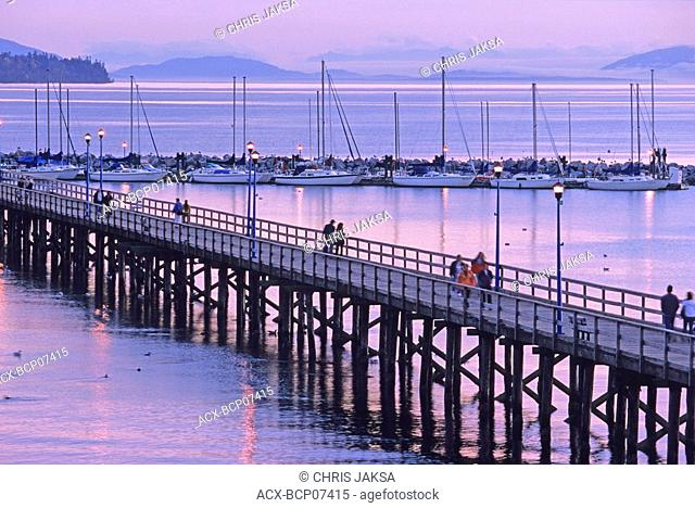 White Rock pier, 500 metres long, built in 1913 as a steamship landing dock, and Boundary Bay at twilight, White Rock, British Columbia, Canada