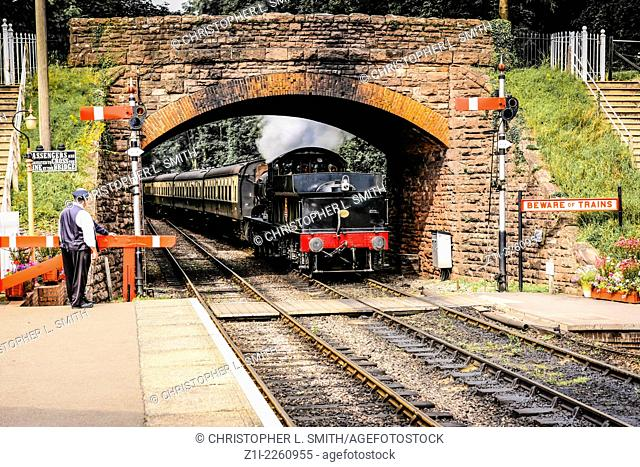 Steam locomotive from Minehead enters Bishops Lydeard Station in Somerset