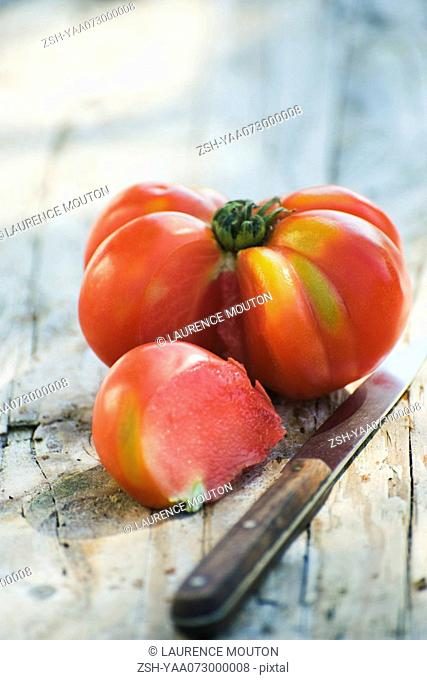 Heirloom tomato with a section cut out of it