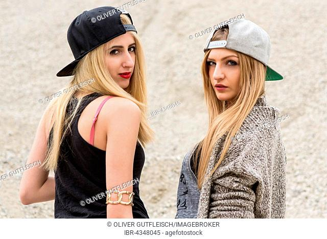 Two young women posing in leisure look, fashion