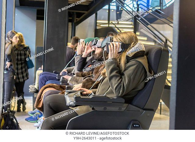 Visitors to the Samsung 837 showroom in the Meatpacking District in New York experience the Samsung VR virtual reality goggles