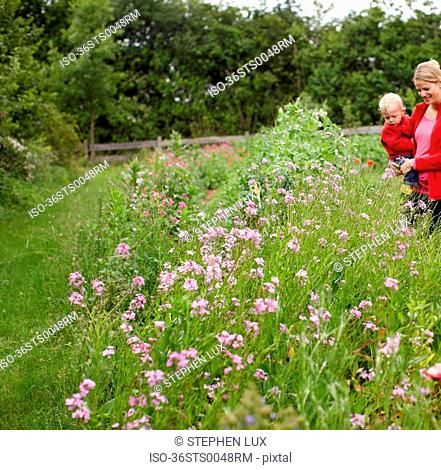 Mother and son in field of flowers