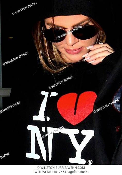 Khole Kardashian and French Montana arriving into Los Angeles International Airport (LAX), wearing matching 'I Love NY' hooded sweaters Featuring: Khole...