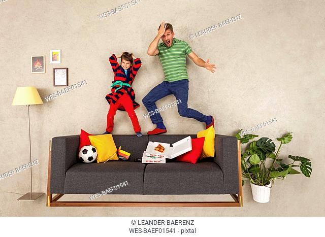 Father and son watching soccer together
