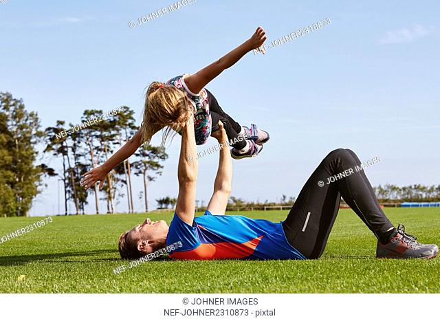 Father exercising with daughter